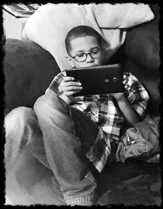 Raymond relaxing on the Tablet